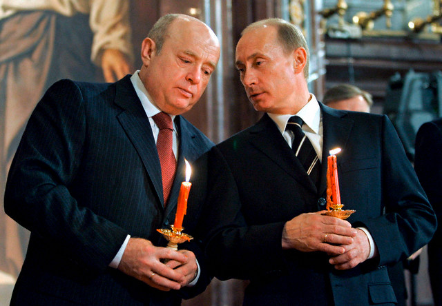 08 Apr 2007, MOSCOW, Russian Federation --- Russian President Vladimir Putin (R) and Prime Minister Mikhail Fradkov (L) during an Easter holiday service in Christ the Saviour Cathedral in Moscow, Russia. President Vladimir Putin on12 September 2007 dismissed the Russian government of Premier Mikhail Fradkov, news agencies in Moscow reported, citing Kremlin spokesman Alexei Gromov.    --- Image by © Dmitry Astakhov/Pool/epa/Corbis