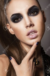 17241059-Sexy-woman-with-long-hair-make-up-and-smokey-eyes-Stock-Photo